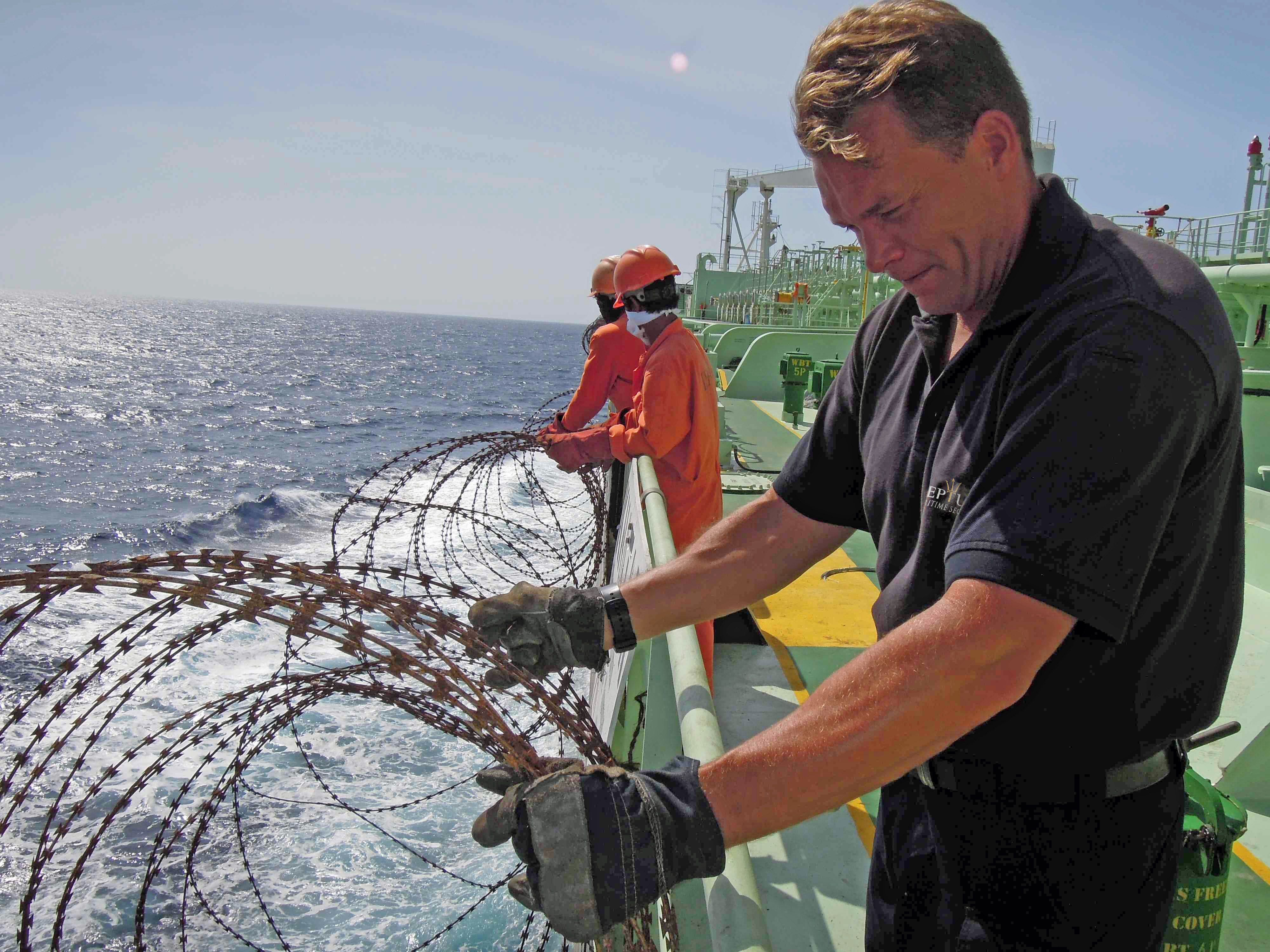 Neptune Maritime Security operative fixed razor wire to sides of ...
